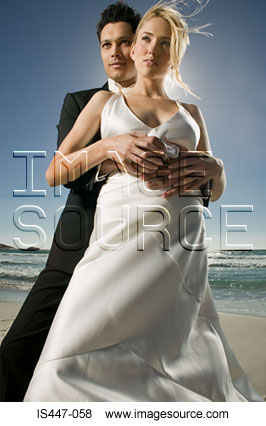Newlywed couple on a beach