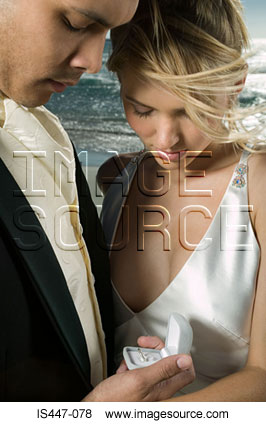 Couple holding a wedding ring